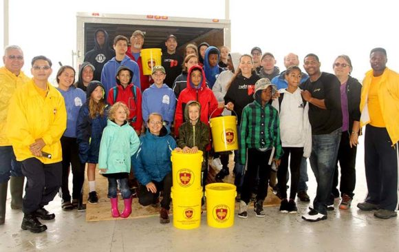Friday Wisconsin Pathfinders Loaded 600 Donated Flood Buckets at Oshkosh International Camporee