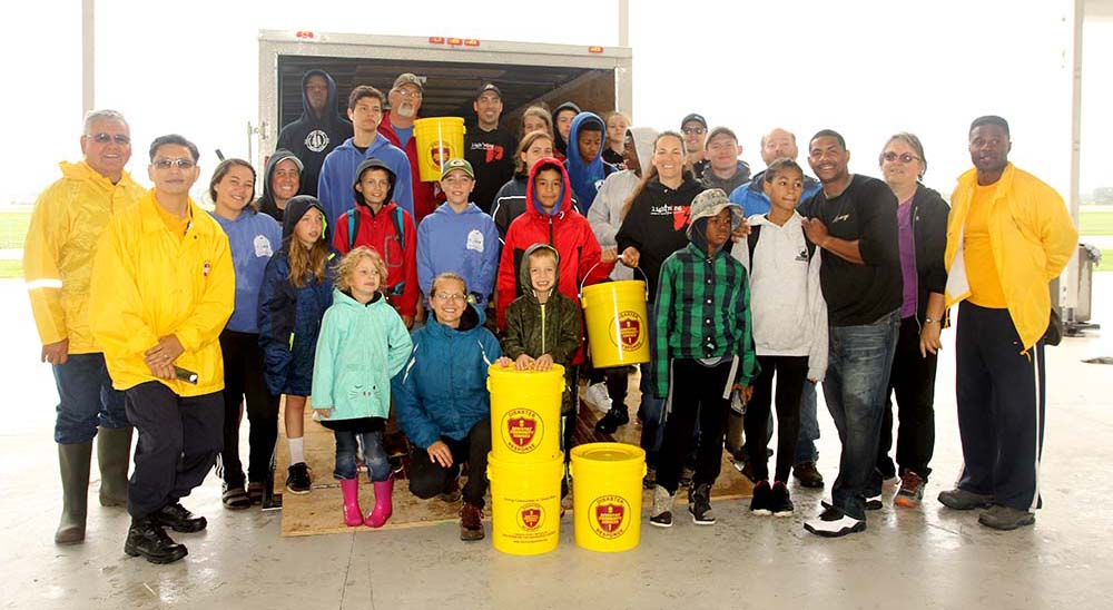 Friday Wisconsin Pathfinders Loaded 600 Donated Flood Buckets at Oshkosh International Camporee