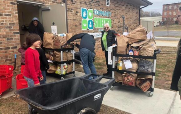 Monroe Pathfinders and Adventurers Deliver 400 Pounds of Food to Shelter