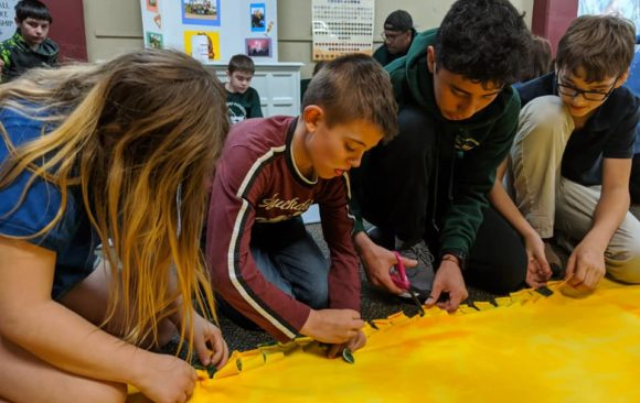 Green Bay Pathfinders Make Blankets for Hospice Patients