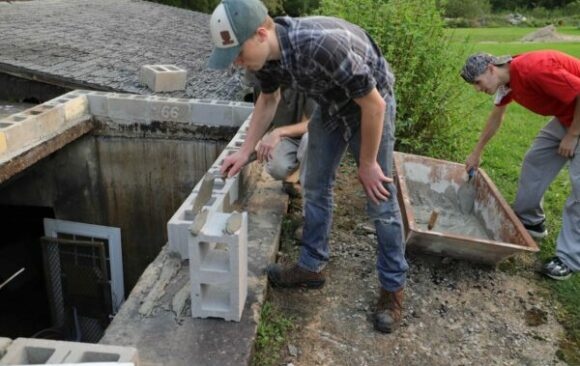 Wisconsin Academy Industrial Arts Students Laying Cement Block